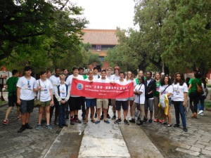 Broward County students, including junior Race Walker and seniors Isaiah Garretson and Jonathan Roman, hold the 2015 Chinese Bridge Summer Camp for U.S. High School Students banner in front of the Temple of Confucius in Beijing, China. The students began their exploration in China by visiting the Temple of Confucius.