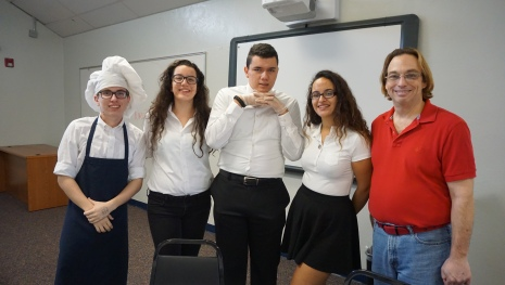 Junior Daniell Llorens, junior Natalie Jehlen, junior Juan Castillo, junior Macarena Vargas and Drama teacher Mr. Henderson pose together before the start of the show. The Murder Cafe performance was held on Jan. 28.